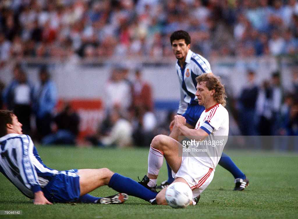 Bayer-Leverkusen-captain-Wolfgang-Rolff-is-tackled-by-Espanol's-Osada