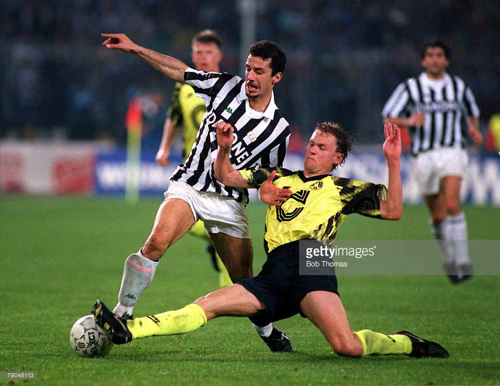 Gianluca-Vialli-of-Juventus-is-tackled-by-Borussia-Dortmund's-Schmidt